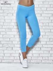 Turkusowe legginsy sportowe termalne z patką z dżetów
