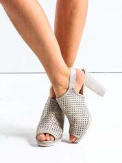 Złote ażurowe sandały na słupku