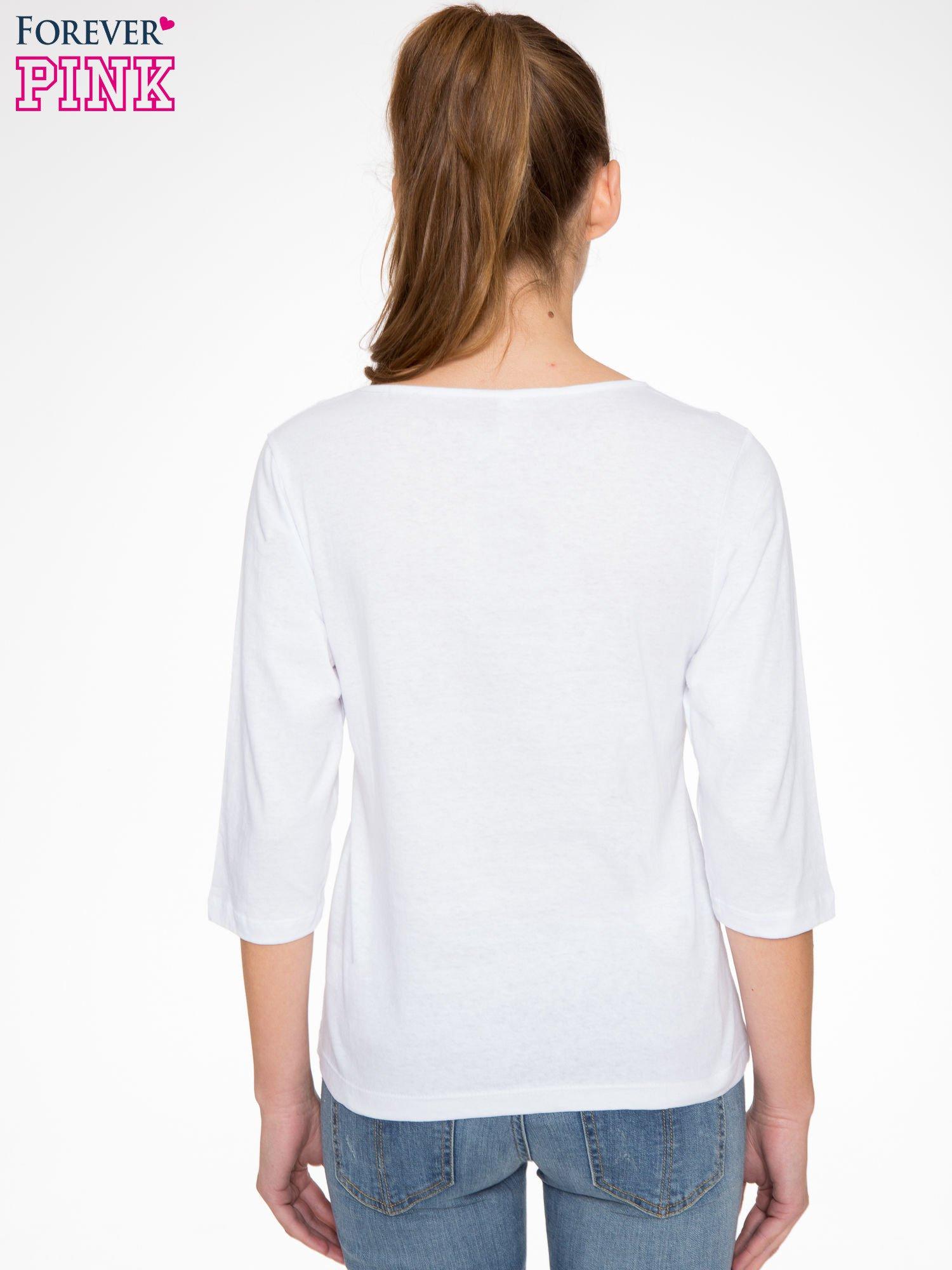 Biała bluzka z nadrukiem róży i napisem BELIEVE                                  zdj.                                  3