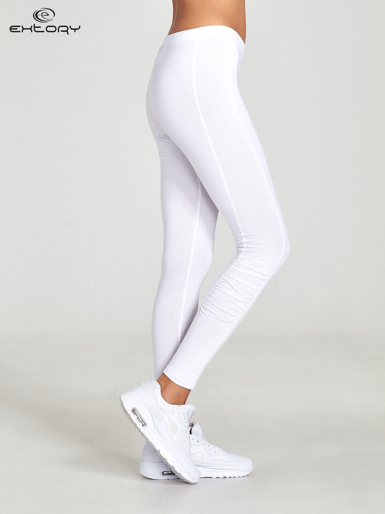 Białe legginsy sportowe z drapowaniem                                  zdj.                                  2