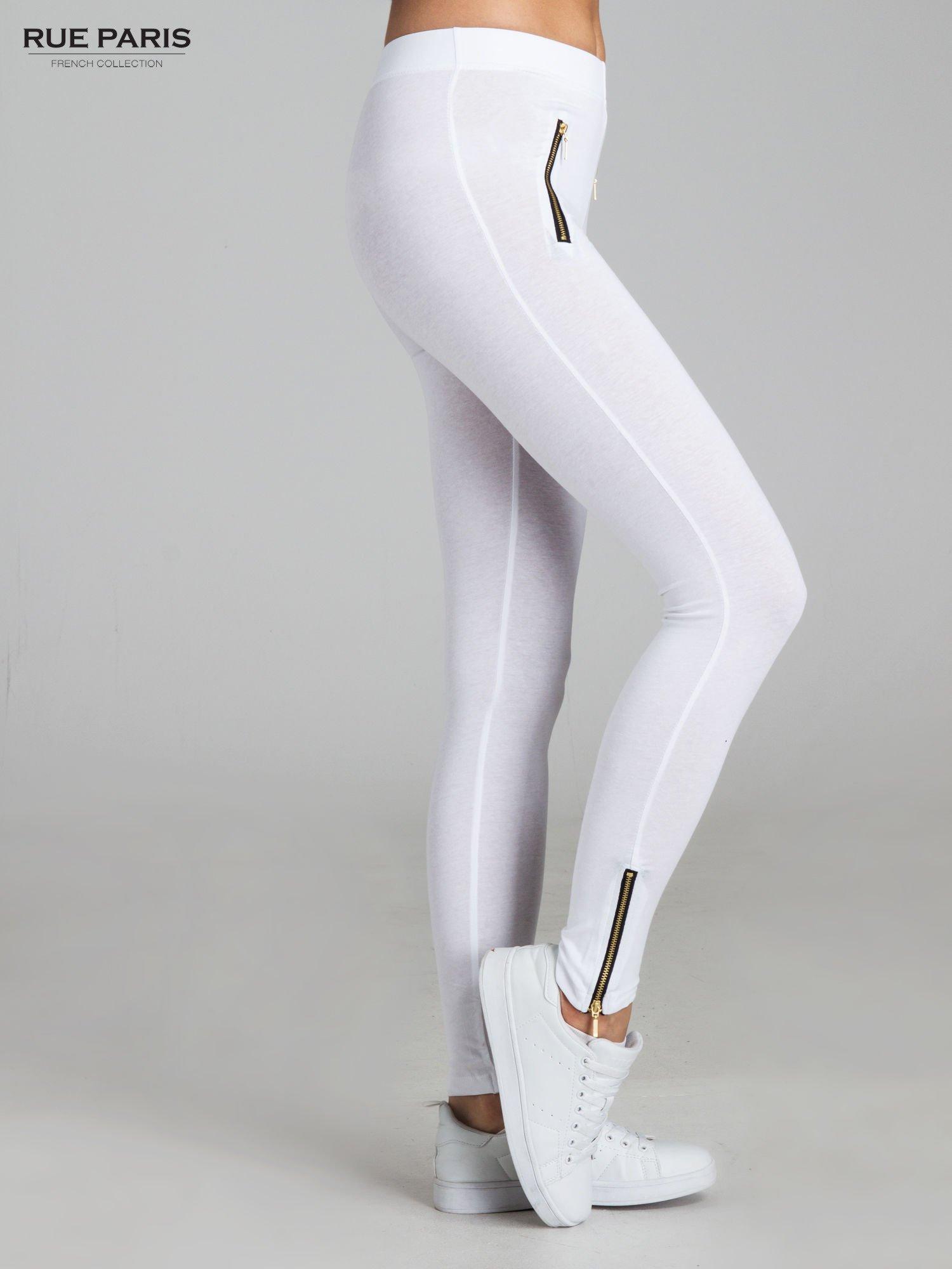 Białe legginsy ze złotymi zamkami                                  zdj.                                  3