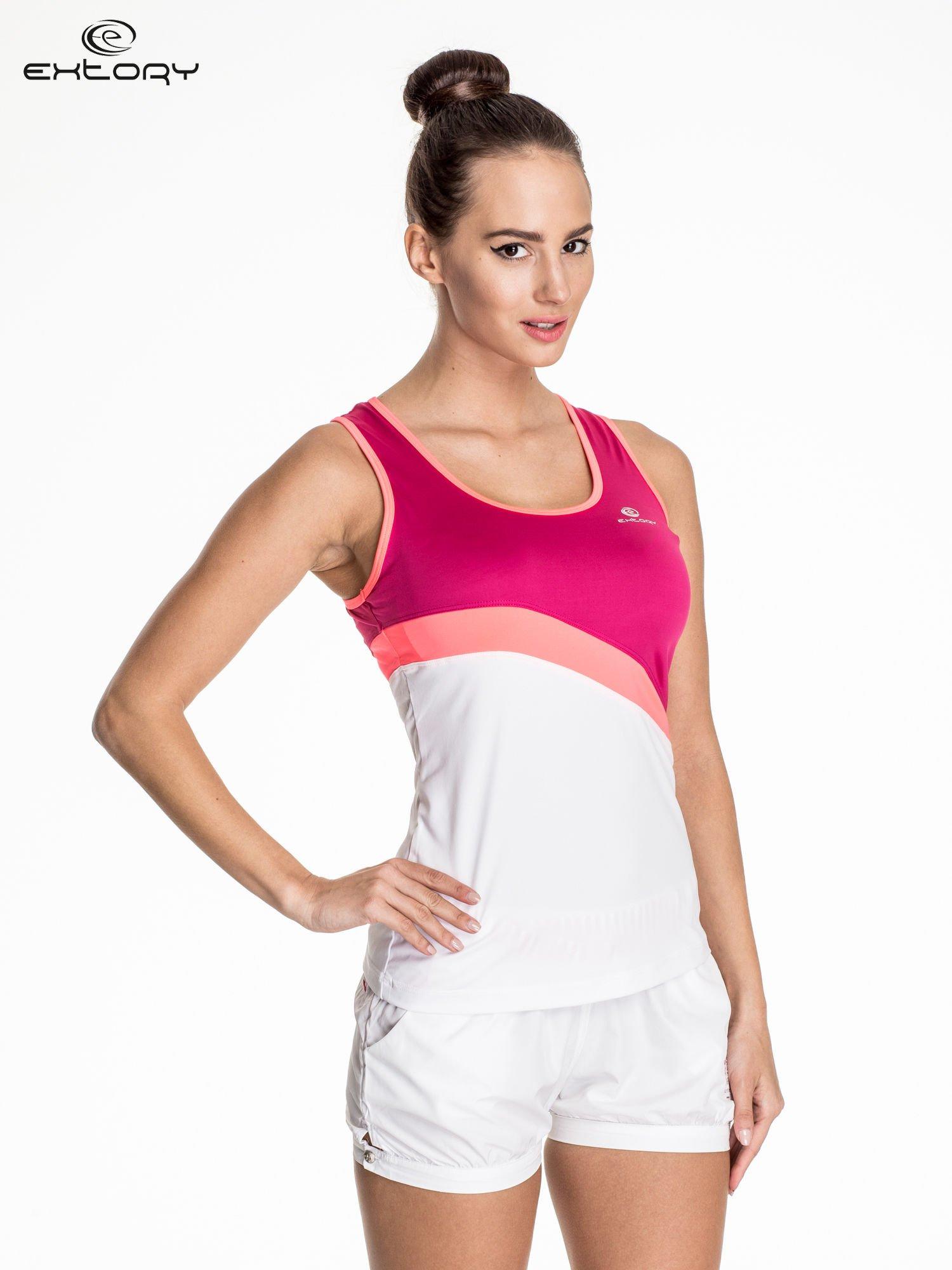 Biały damski top sportowy z różowym modułem                                  zdj.                                  1