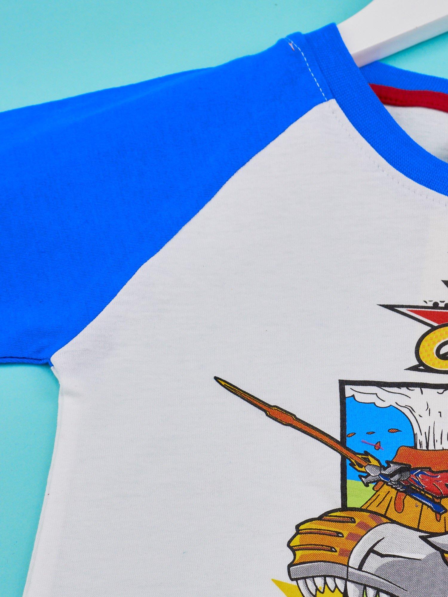 Biały t-shirt chłopięcy z nadrukiem TRANSFORMERS                                  zdj.                                  3