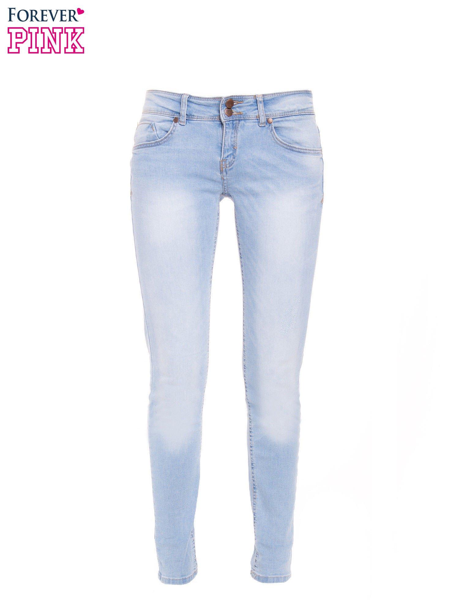 Błękitne jeansy rurki wycierane                                  zdj.                                  2