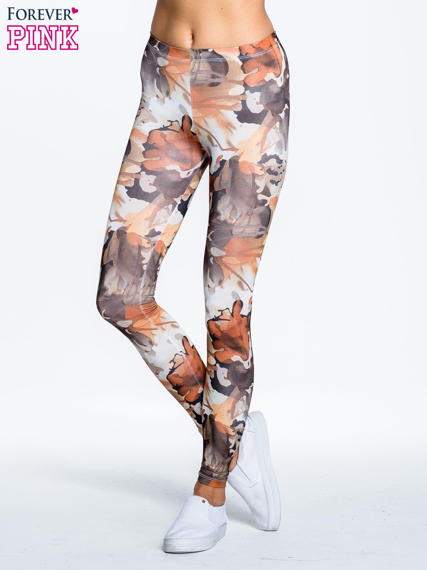 Brązowe legginsy w wielobarwne wzory                                  zdj.                                  1