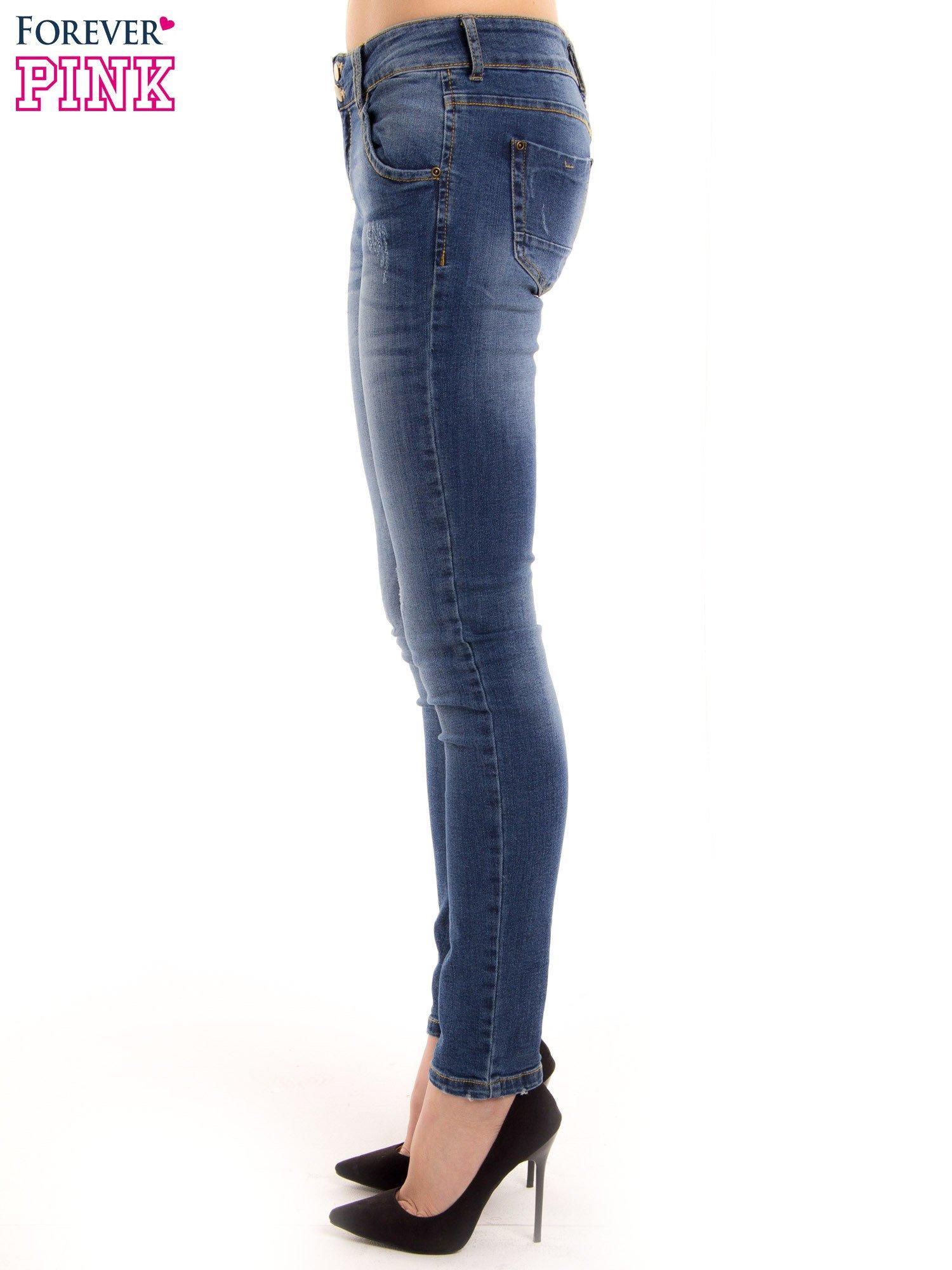 Ciemnieniebieskie jeansy biodrówki na dwa guziki                                  zdj.                                  3