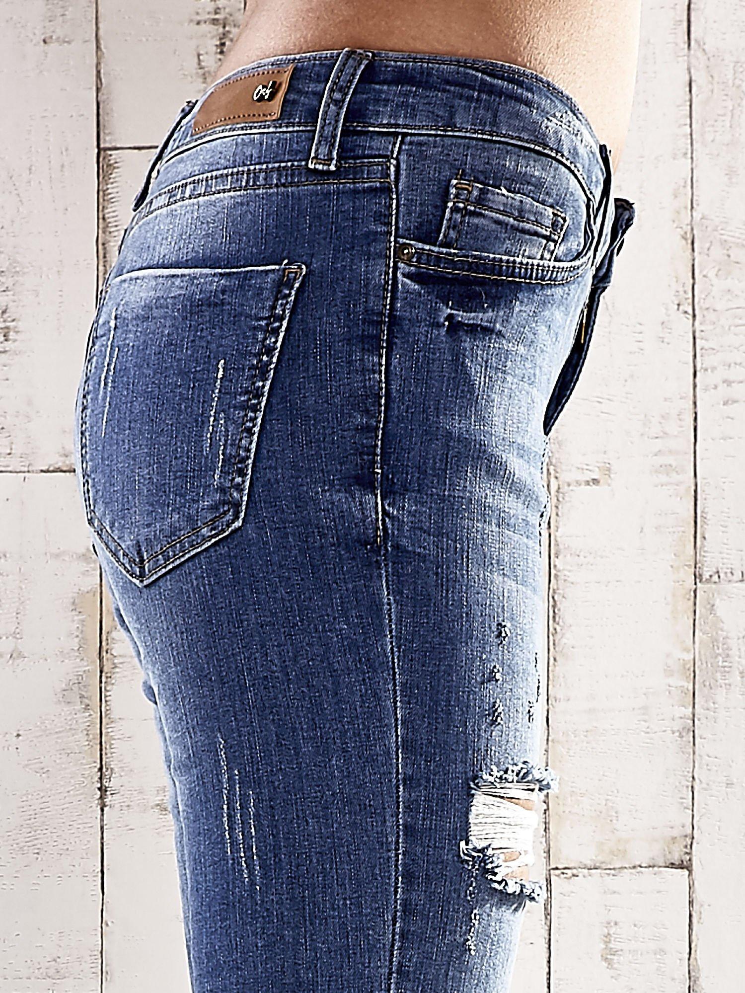 Ciemnoniebieskie spodnie skinny jeans z dziurami                                  zdj.                                  5