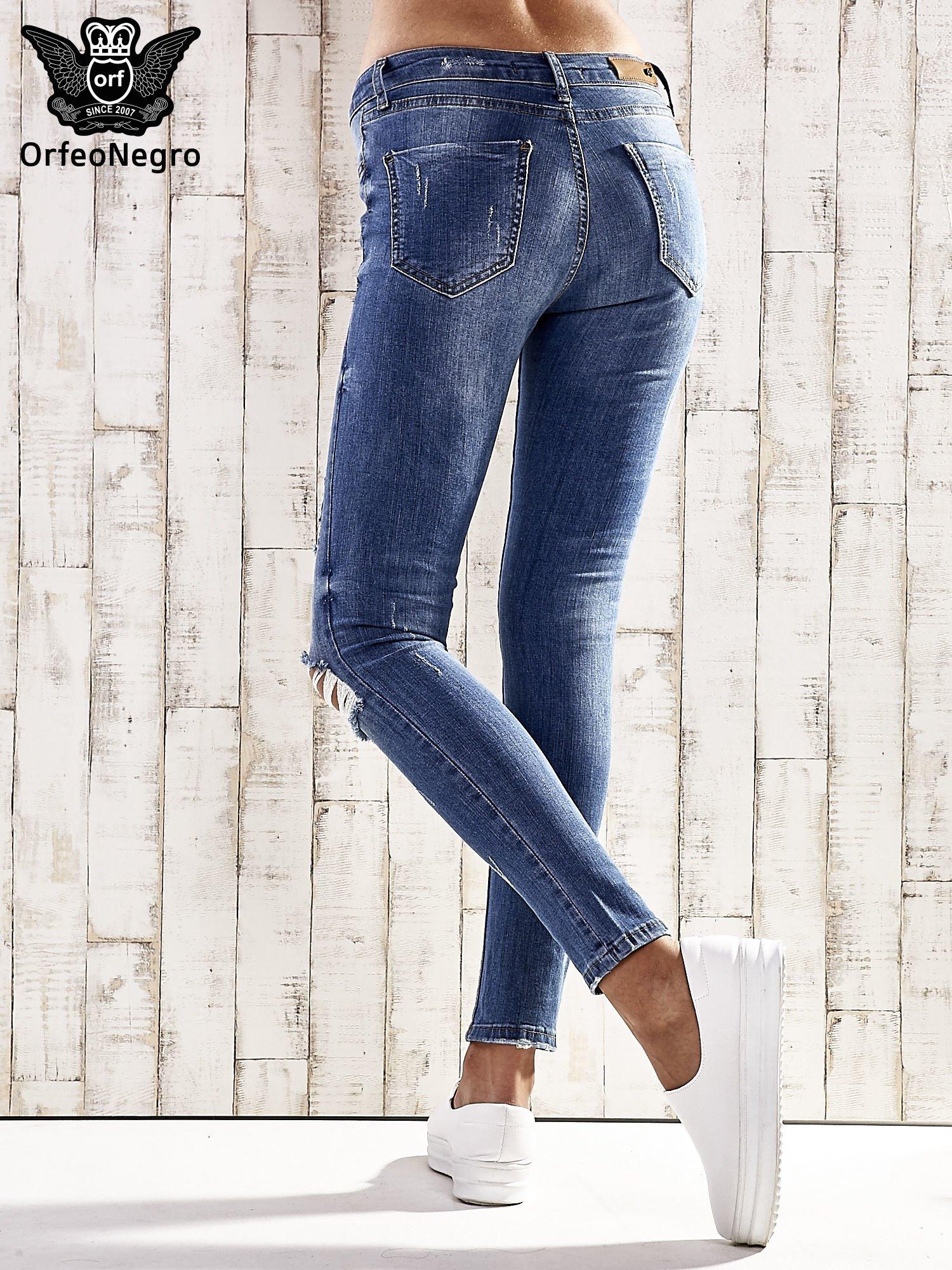 Ciemnoniebieskie spodnie skinny jeans z dziurami                                  zdj.                                  3