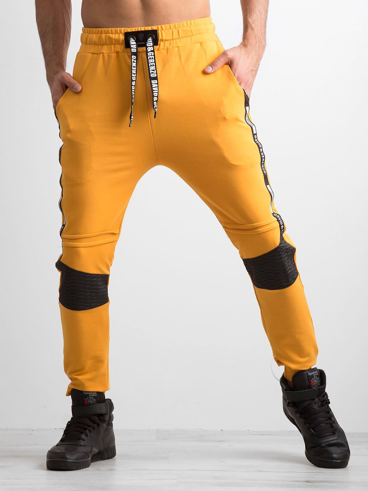 Ciemnożółte męskie spodnie dresowe z napisami