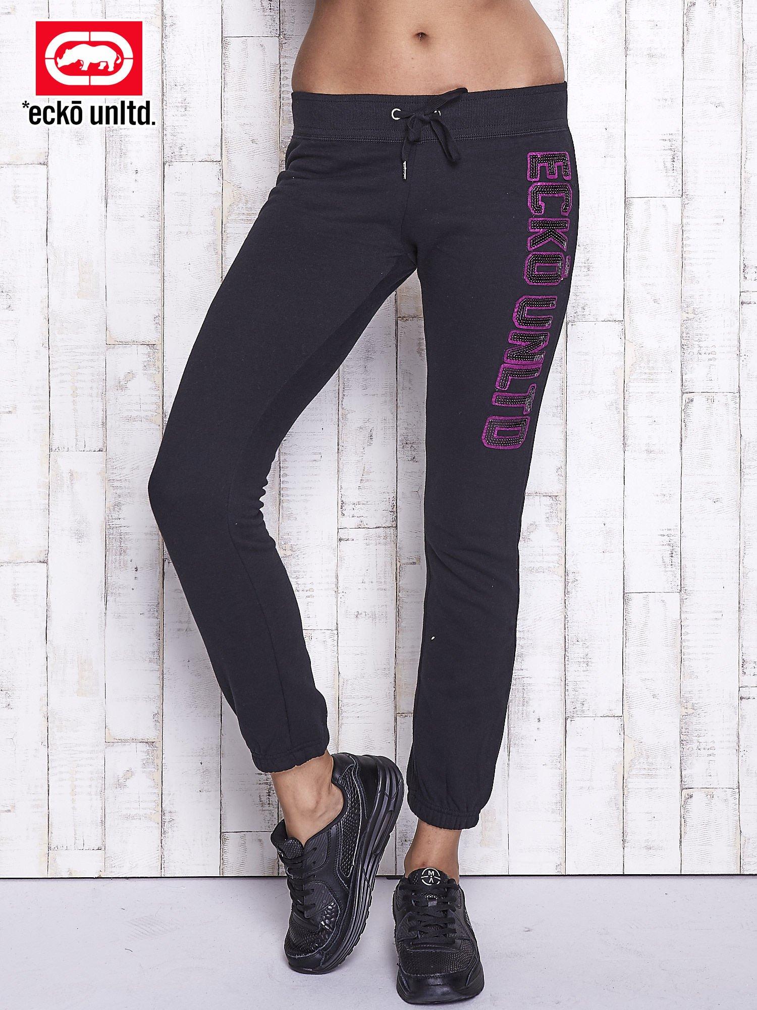 Czarne spodnie dresowe z cekinami                                  zdj.                                  1