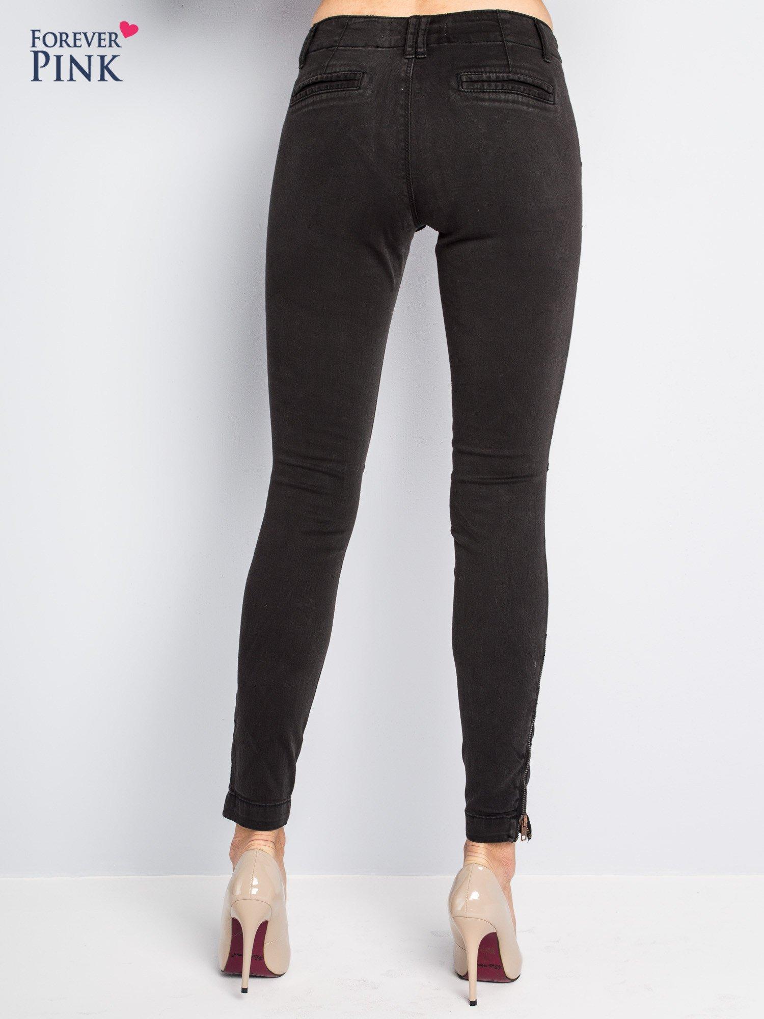 Czarne spodnie typu rurki z suwakami wzdłuż nogawek i z przodu                                  zdj.                                  7