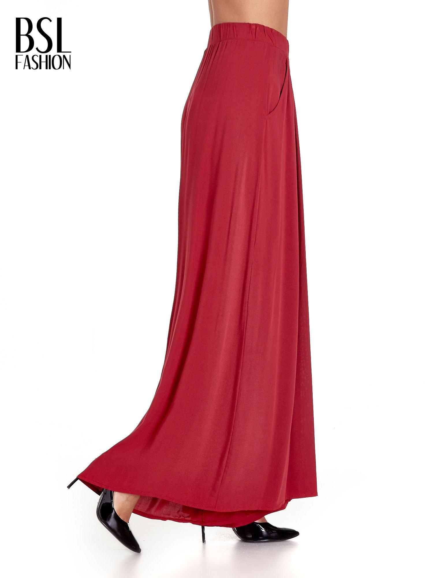 Czerwone zwiewne spodnie typu culottes                                  zdj.                                  3