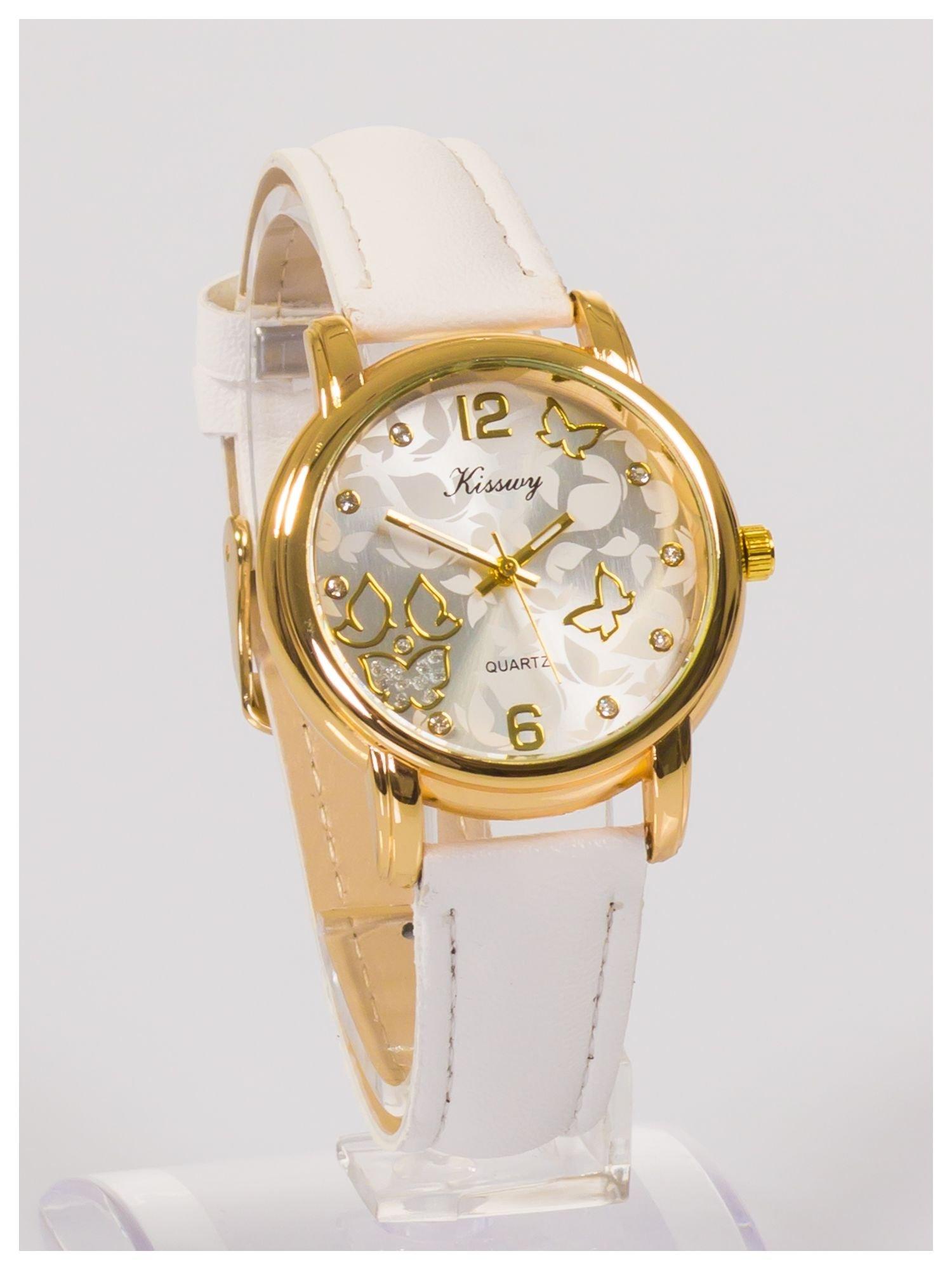 Damski zegarek z ozdobnym wzorem na tarczy.                                  zdj.                                  3