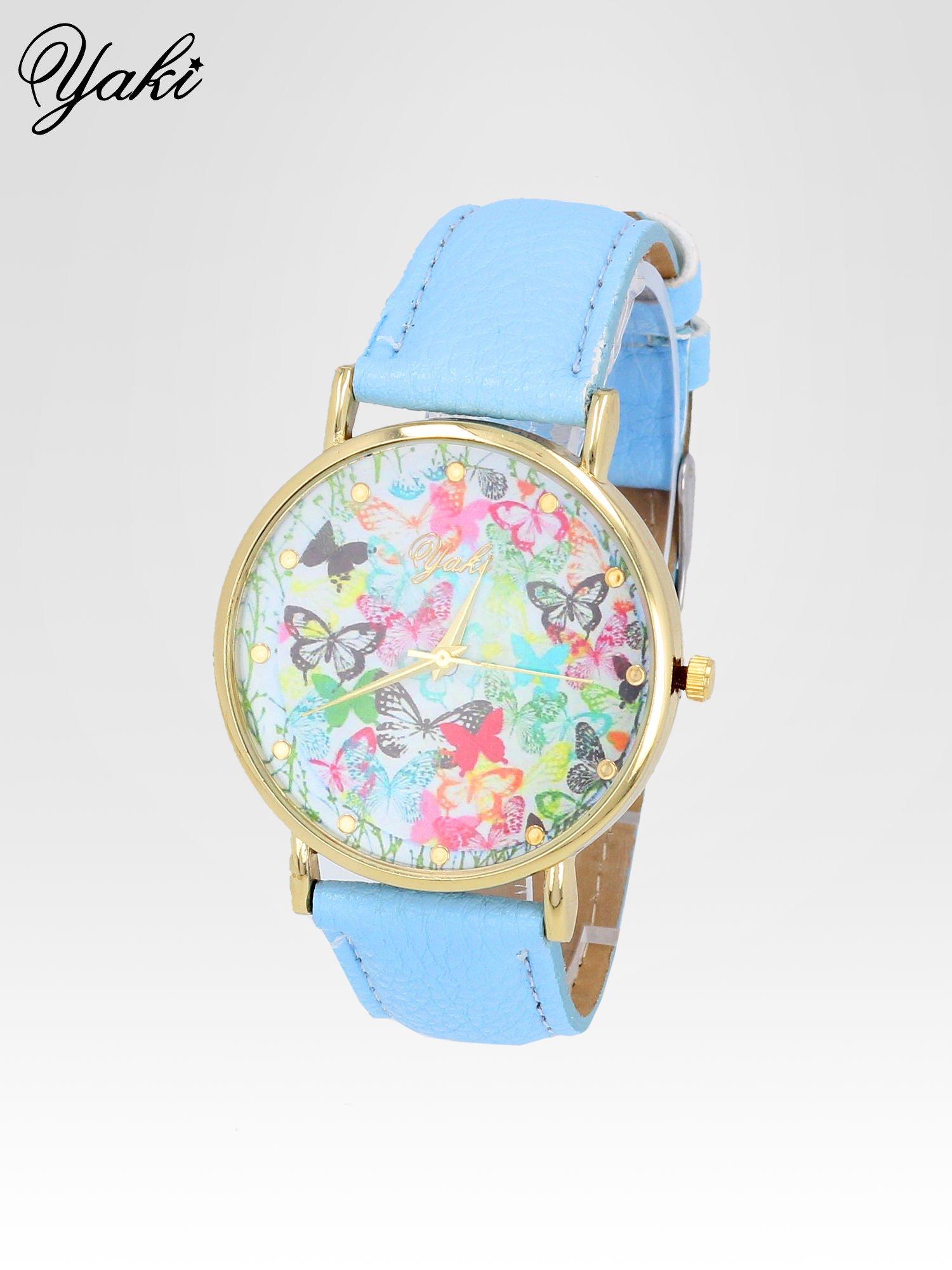 Jasnoniebieski zegarek damski na pasku z kwiatową tarczą                                  zdj.                                  2
