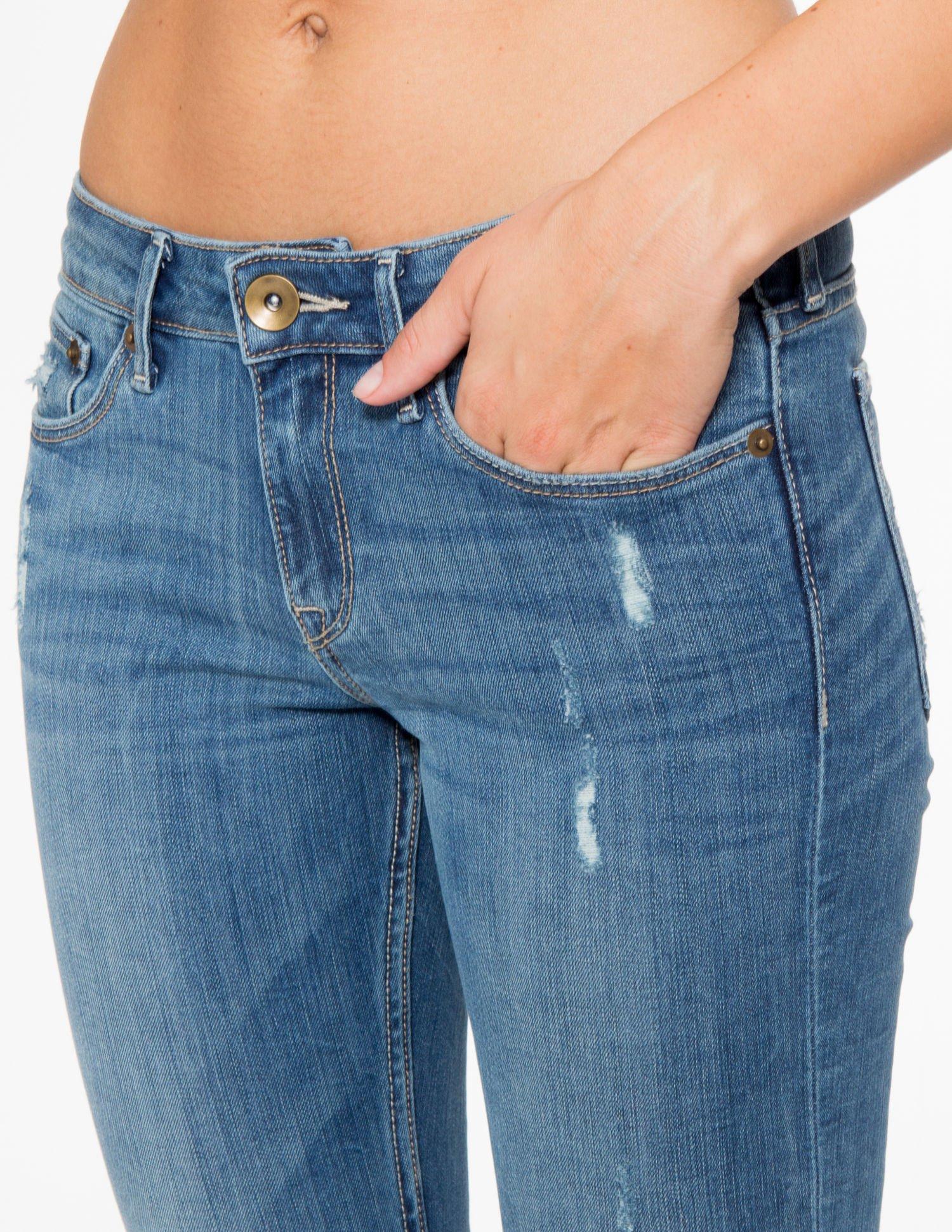 Jasnoniebieskie spodnie jeansowe z przetarciami                                  zdj.                                  9