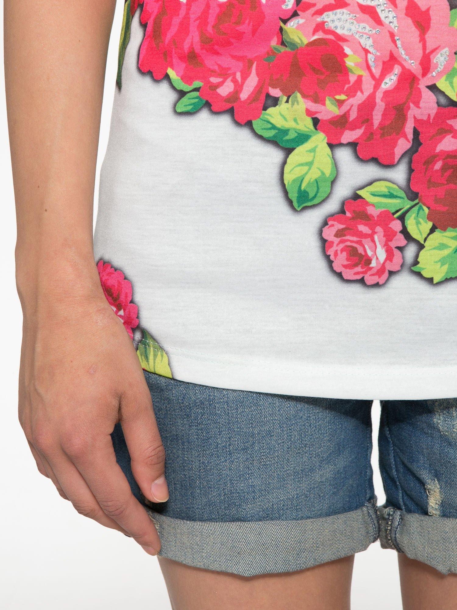 Jasnozielony t-shirt z kwiatowym nadrukiem i napisem UNREAL                                  zdj.                                  6