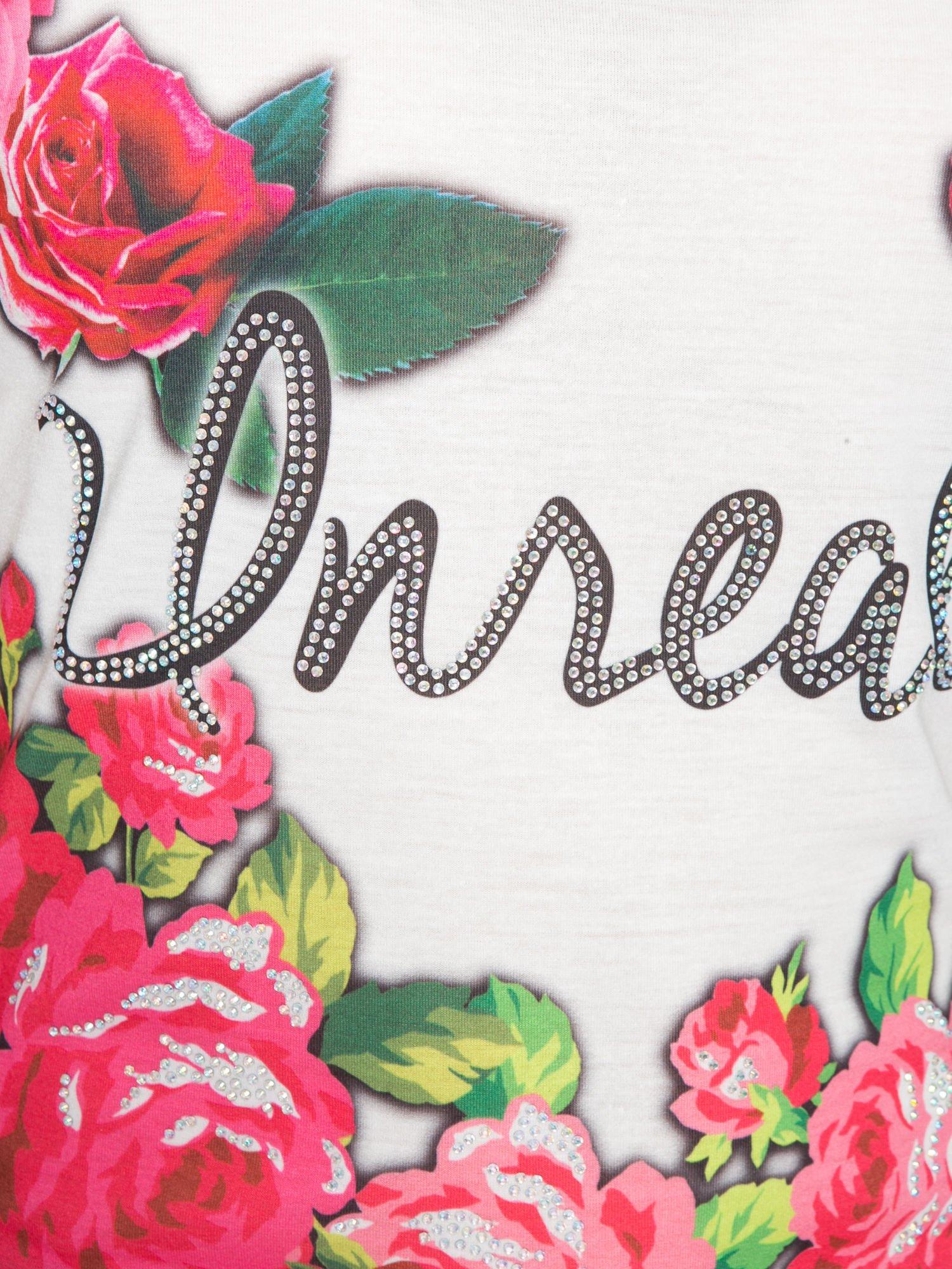 Jasnozielony t-shirt z kwiatowym nadrukiem i napisem UNREAL                                  zdj.                                  8