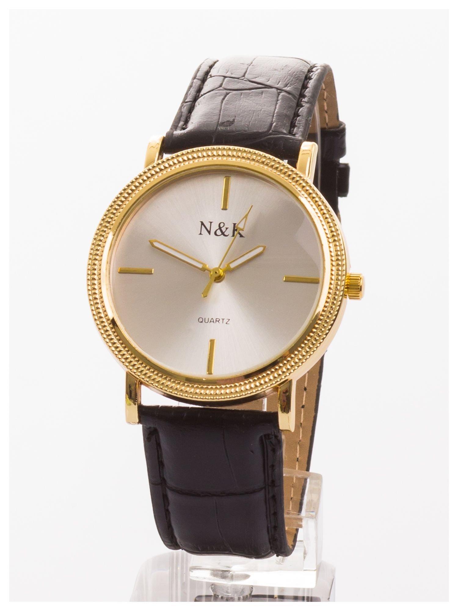 Klasyczny damski zegarek z elegancką i czytelną tarczą. Czarny skórzany pasek. Ozdobna koperta                                  zdj.                                  1