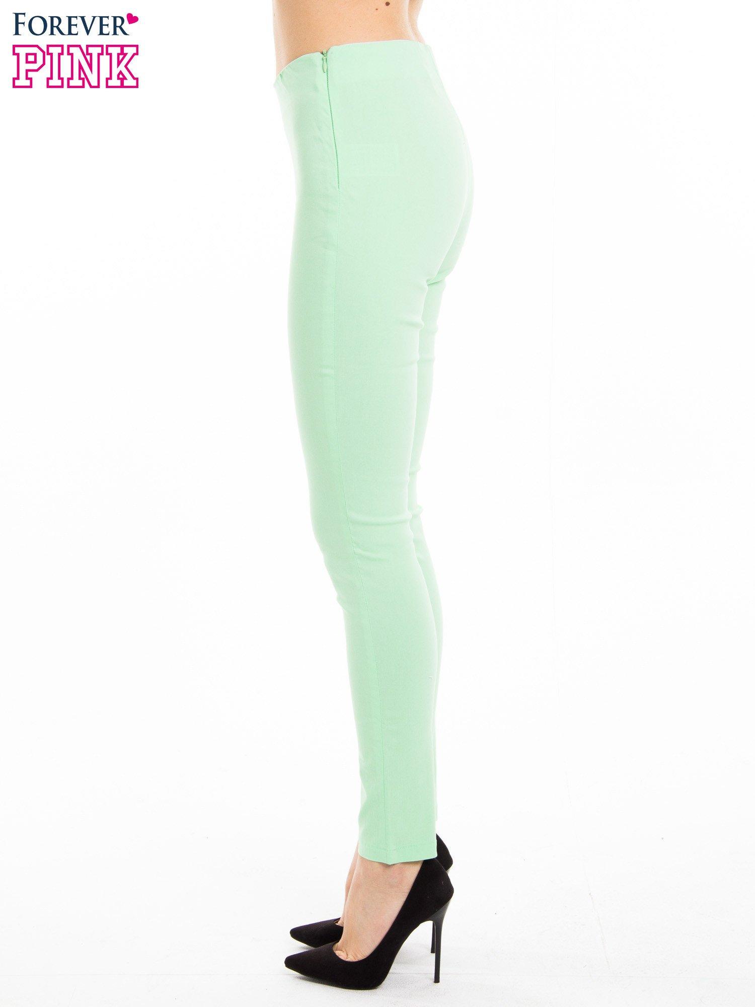 Miętowe dopasowane spodnie typu tregginsy                                  zdj.                                  2