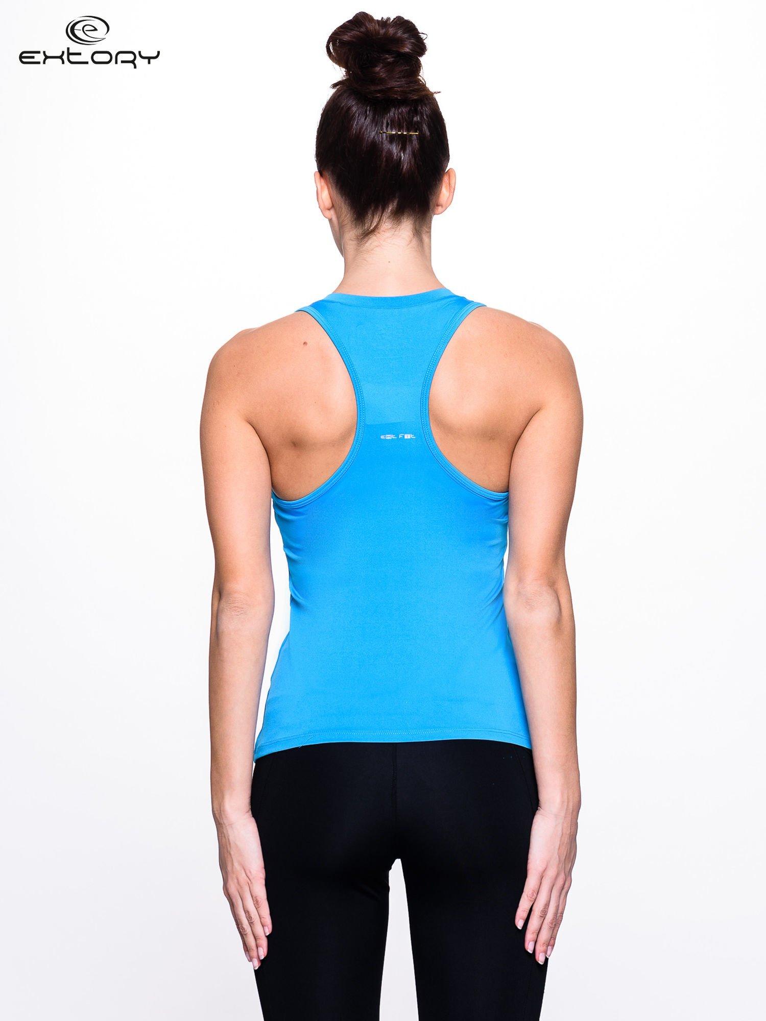 Niebieski top fitness z dekoltem V                                  zdj.                                  4