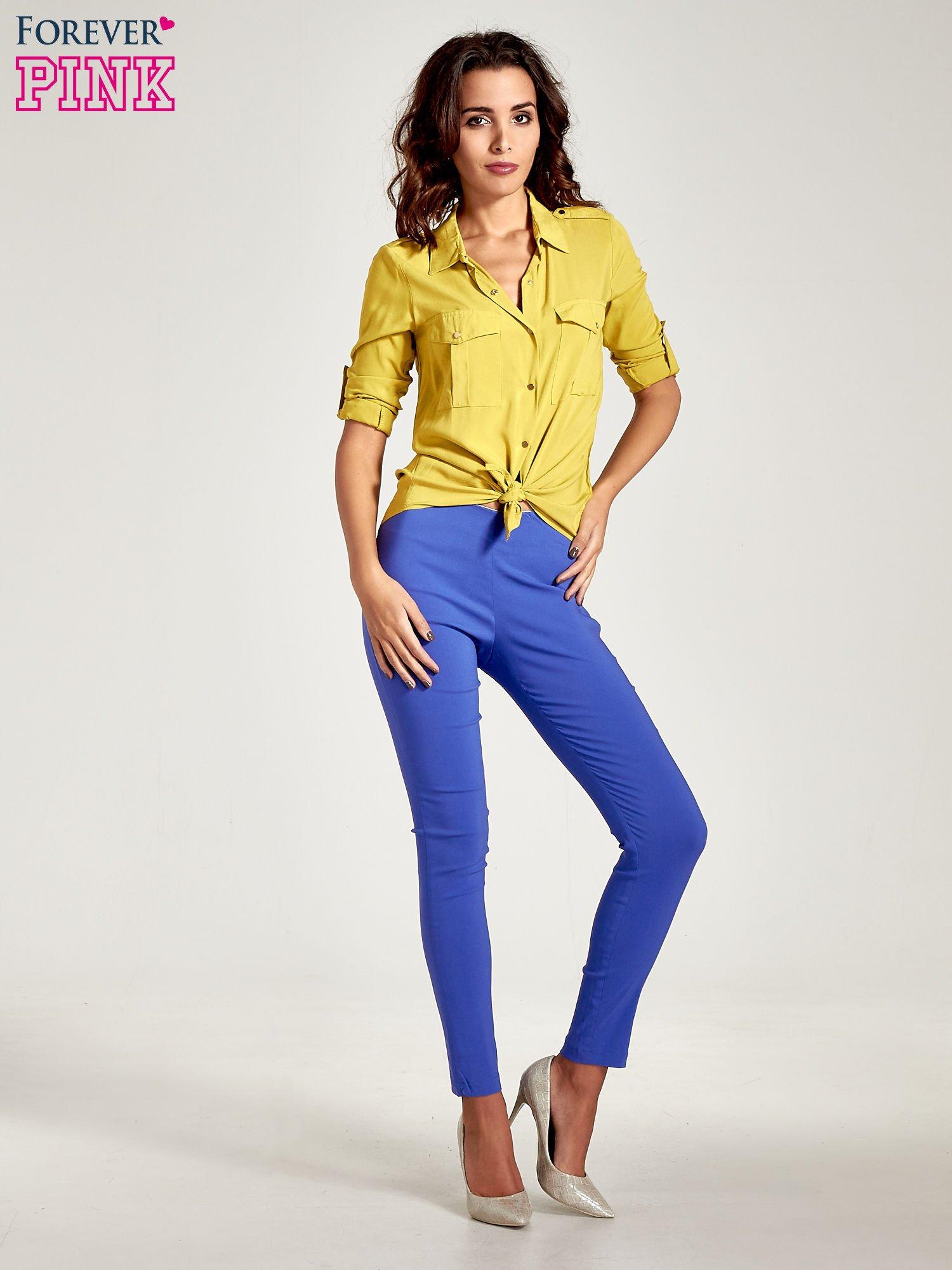 Niebieskie dopasowane spodnie typu tregginsy                                  zdj.                                  9