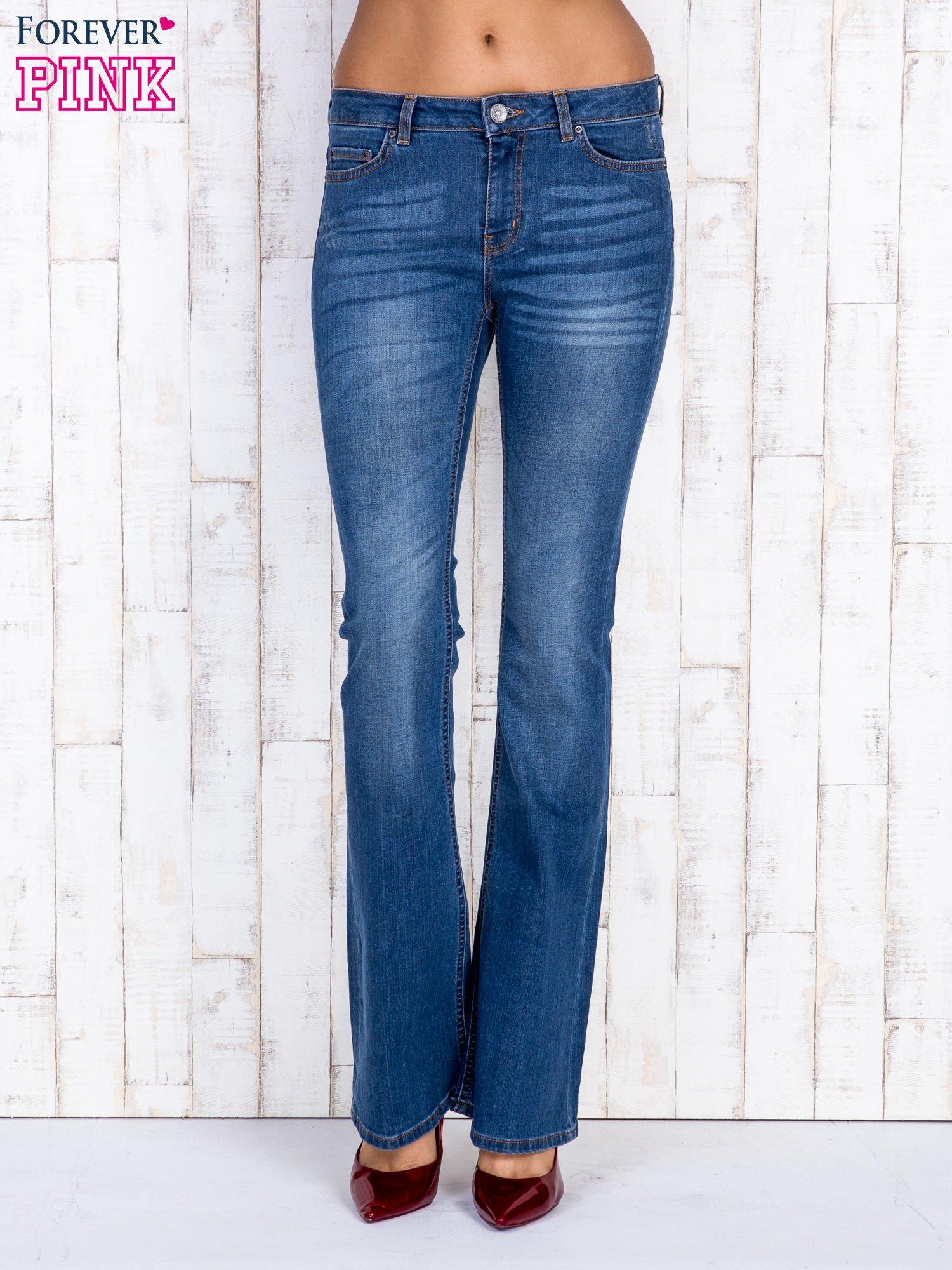 Niebieskie jeansowe spodnie dzwony z przetarciami                                  zdj.                                  1