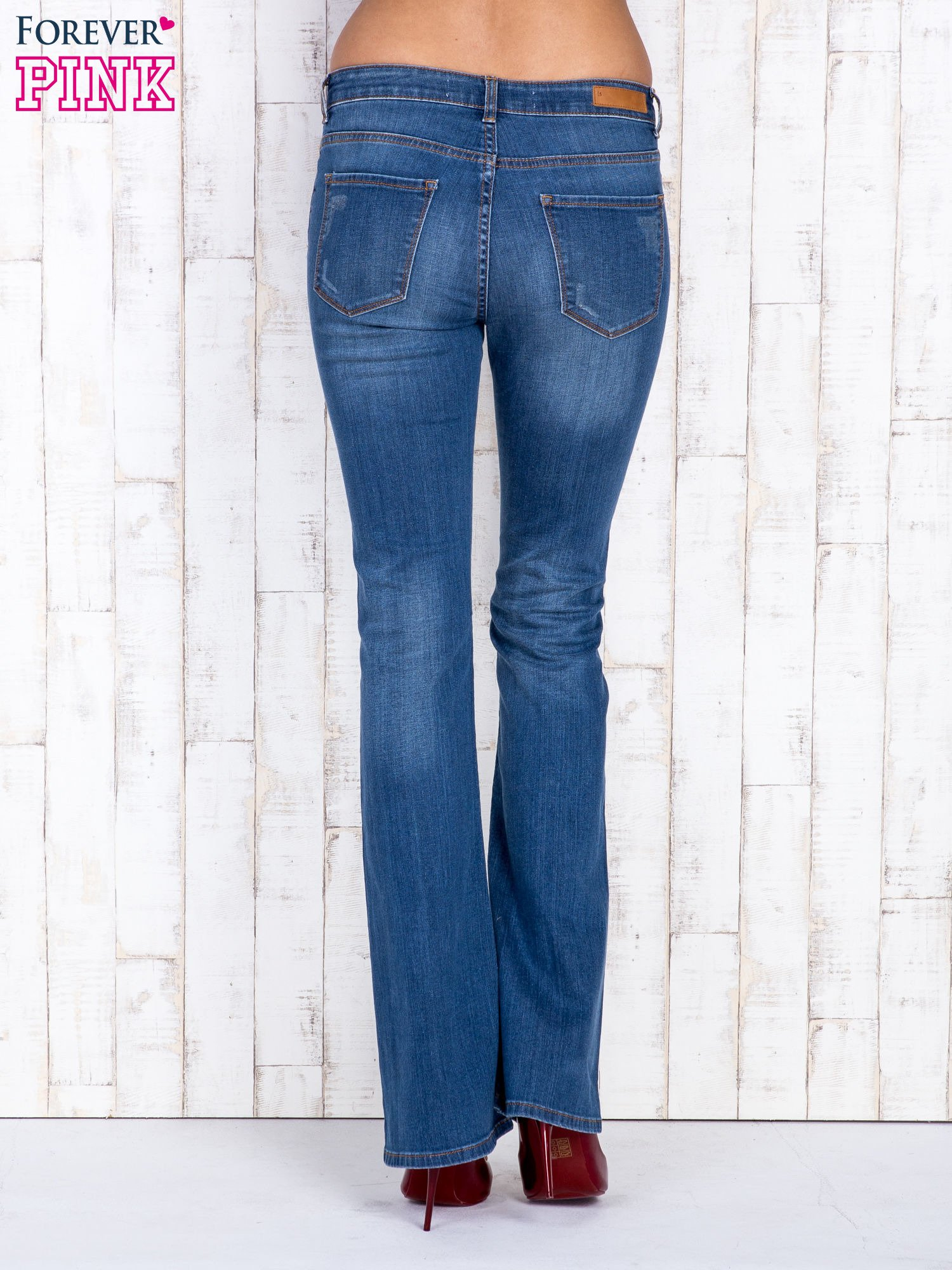 Niebieskie jeansowe spodnie dzwony z przetarciami                                  zdj.                                  2