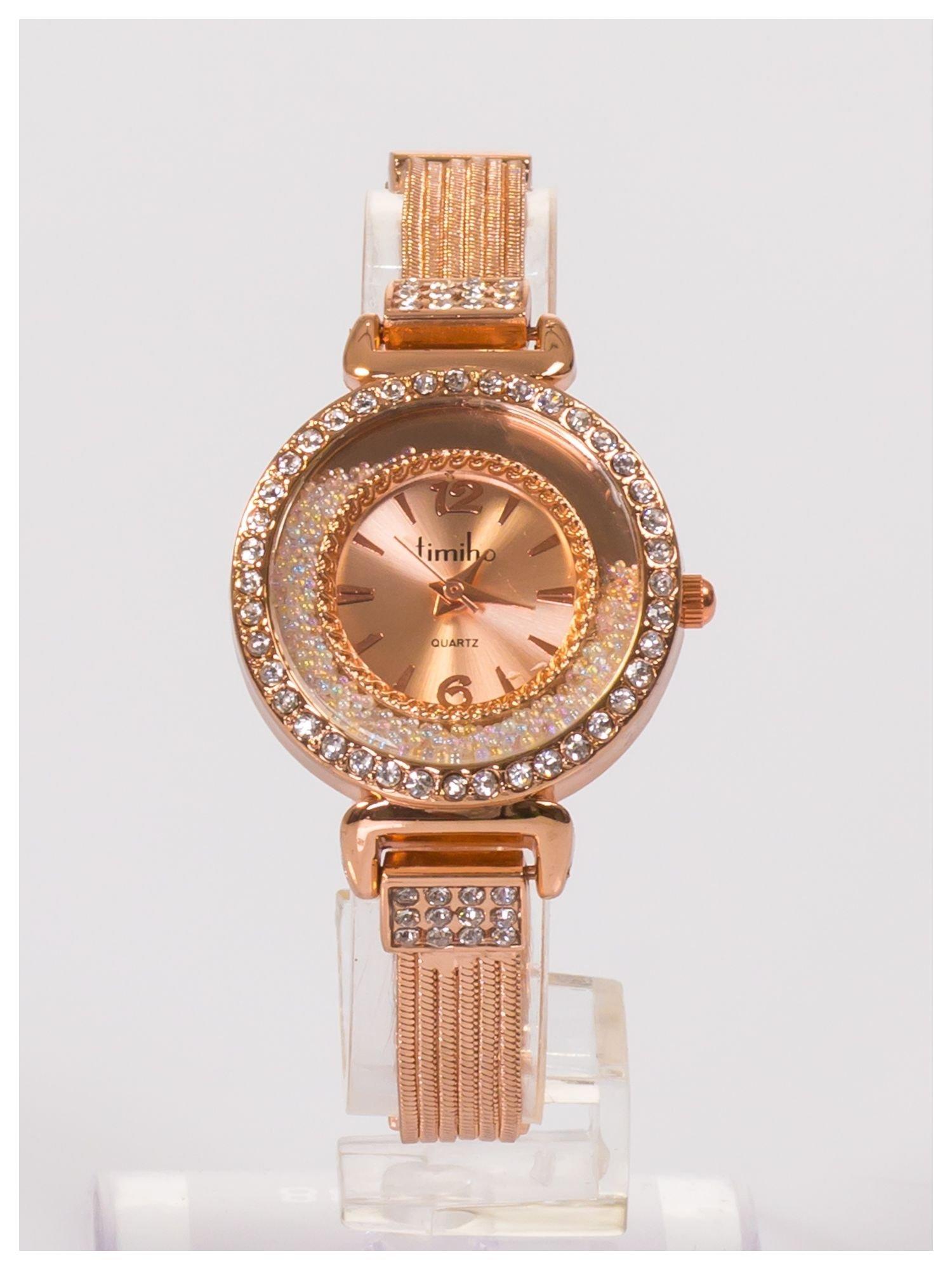 Ozdobny damski zegarek z cyrkoniami, w kolorze różowego złota, na stalowej bransolecie z łańcuszkami                                  zdj.                                  1