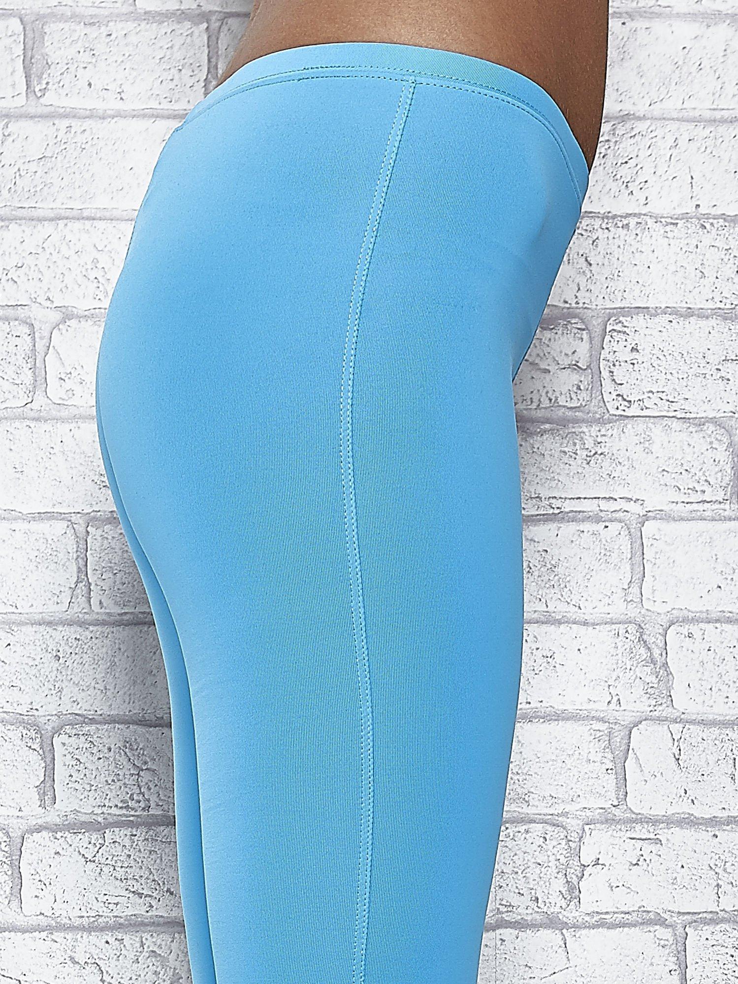 Turkusowe legginsy sportowe termalne z dżetami na nogawkach                                  zdj.                                  6