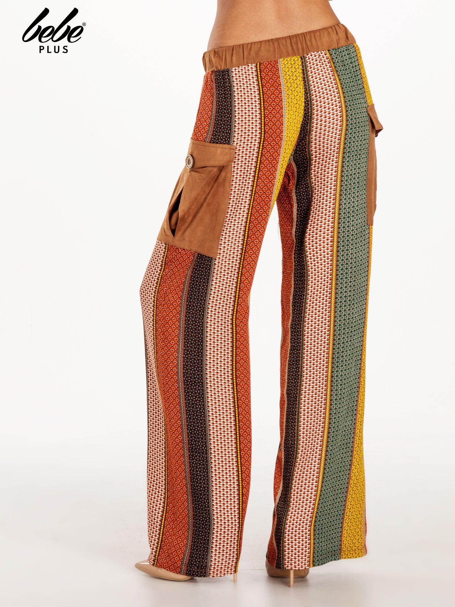 Wzorzyste spodnie palazzo z kieszeniami                                  zdj.                                  4