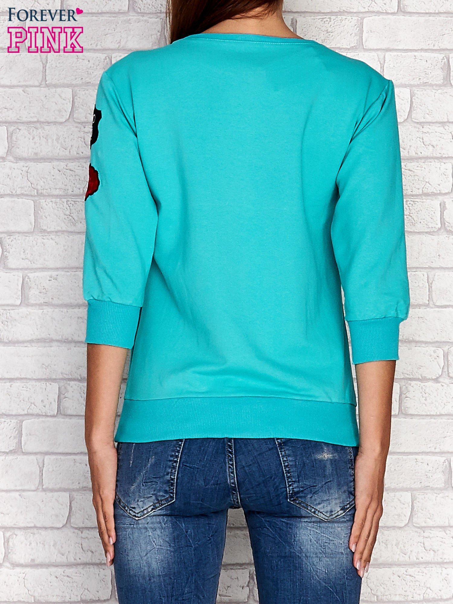 Zielona bluza z naszywkami na rękawie                                  zdj.                                  4
