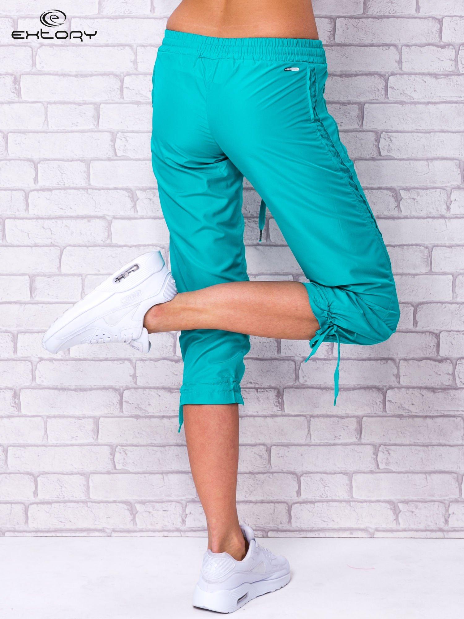 Zielone spodnie sportowe capri z siateczką                                  zdj.                                  3