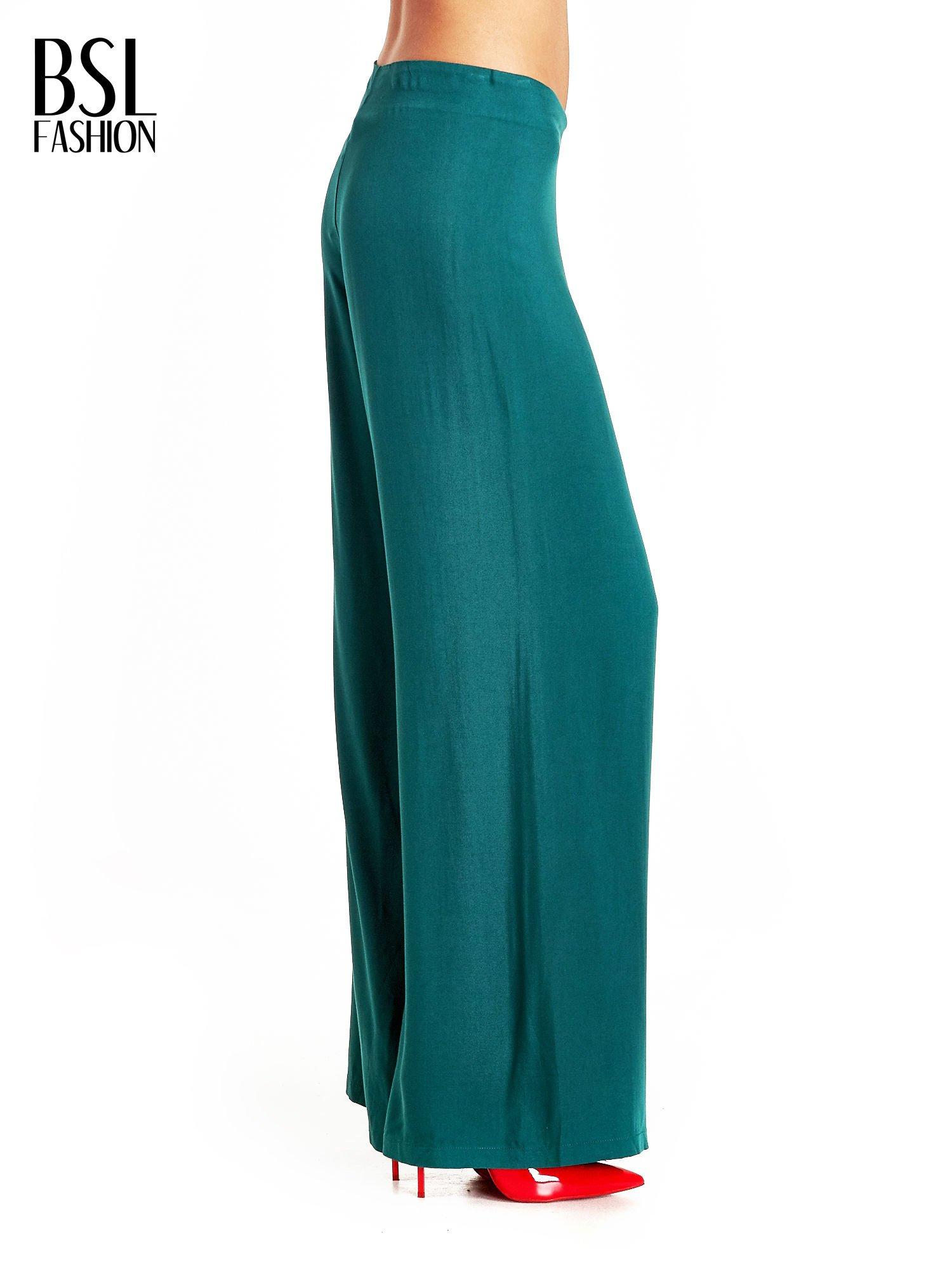 Zielone zwiewne spodnie typu palazzo                                  zdj.                                  3