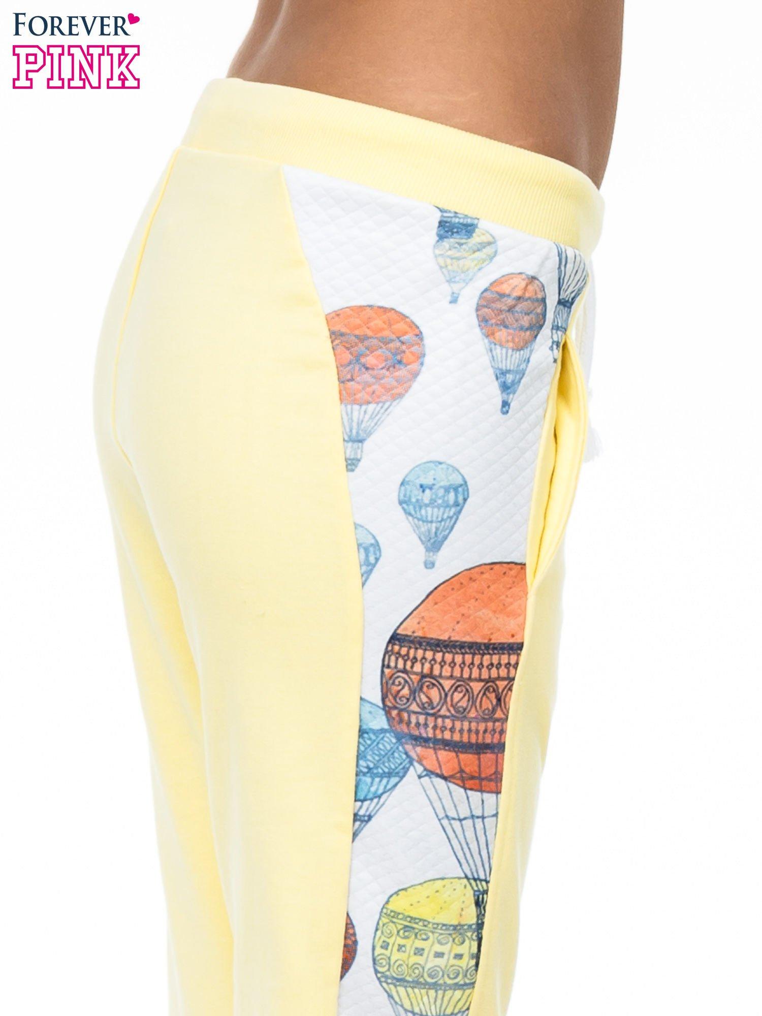 Żółte spodnie dresowe z lampasem w balony                                  zdj.                                  5
