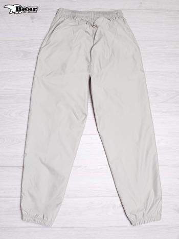 BEAR USA Beżowe spodnie dresowe męskie                                  zdj.                                  2