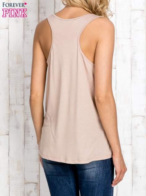 Beżowa bluzka koszulowa z nadrukiem w zebry                                  zdj.                                  2