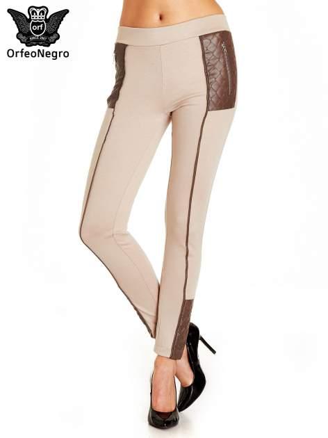 Beżowe spodnie w stylu motocyklowym ze skórzanymi wstawkami i suwakami                                  zdj.                                  1