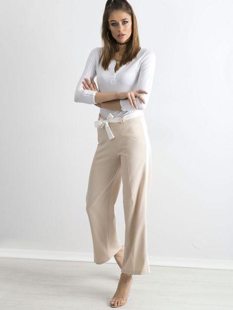 Beżowe szerokie spodnie z lampasami                              zdj.                              4