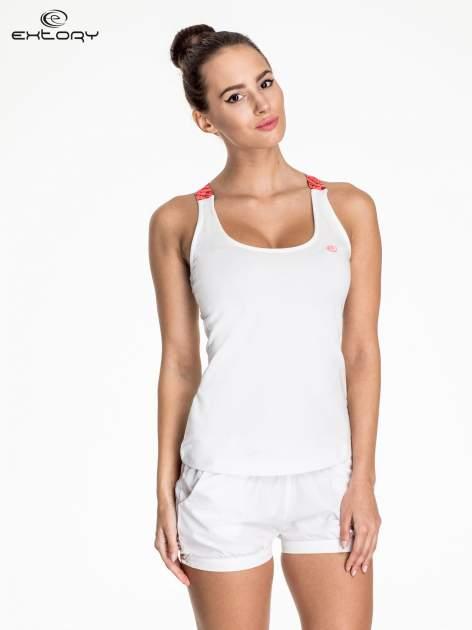 Biały top sportowy z różowymi ramiączkami na krzyż                                  zdj.                                  1