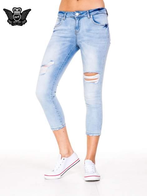 Błękitne spodnie skinny jeans do połowy łydki z rozdarciami                                  zdj.                                  1