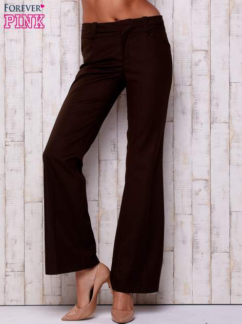 Brązowe materiałowe rozszerzane spodnie