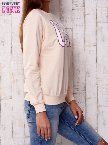 Brzoskwiniowa bluza z napisem USA                                  zdj.                                  3