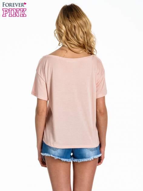 Brzoskwiniowy t-shirt z nadrukiem nieskończoności                                  zdj.                                  4