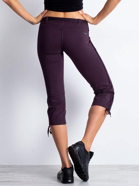 Ciemnofioletowe dresowe spodnie capri z materiałowym paskiem                                  zdj.                                  5