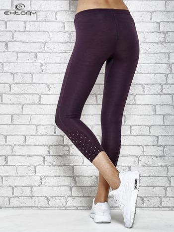 Ciemnofioletowe legginsy sportowe z aplikacją z dżetów na nogawkach                                  zdj.                                  2