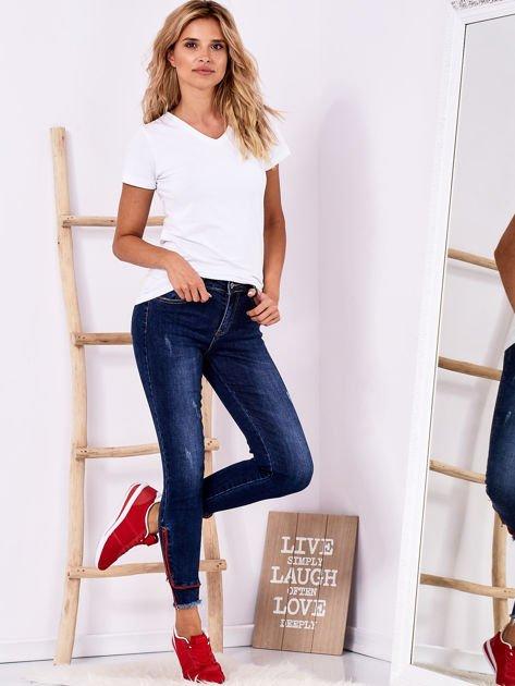 Ciemnoniebieskie jeansowe spodnie z suwakami                              zdj.                              4