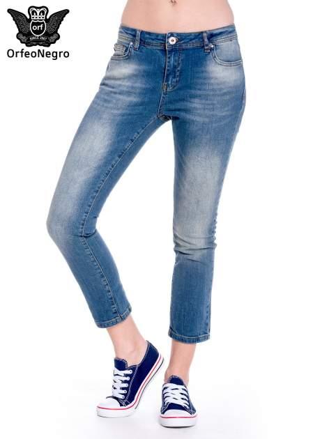Ciemnoniebieskie spodnie girlfriend jeans z cieniowaniem