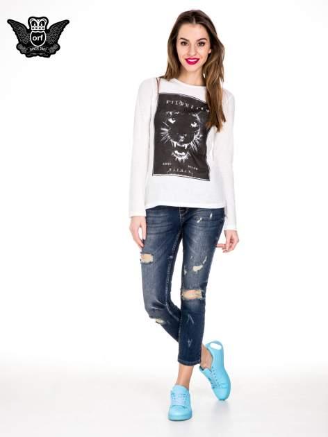 Ciemnoniebieskie spodnie jeansowe rurki z dużymi dziurami                                  zdj.                                  4