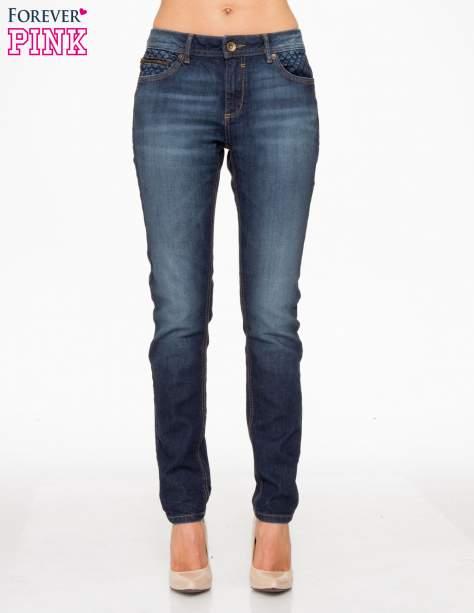 Ciemnoniebieskie spodnie jeansowe rurki z pikowanymi wstawkami                                  zdj.                                  1