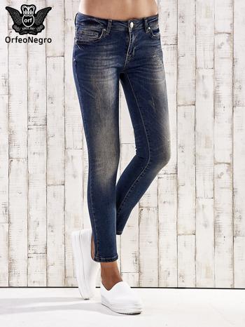 Ciemnoniebieskie spodnie skinny jeans z ćwiekami                                  zdj.                                  1